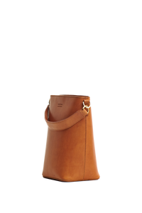 Shop bobbi bucket bag cognac classic leather by O My Bag on thegreenlabels