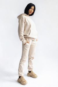 shop almond latte loose pants by capsule studio at thegreenlabels