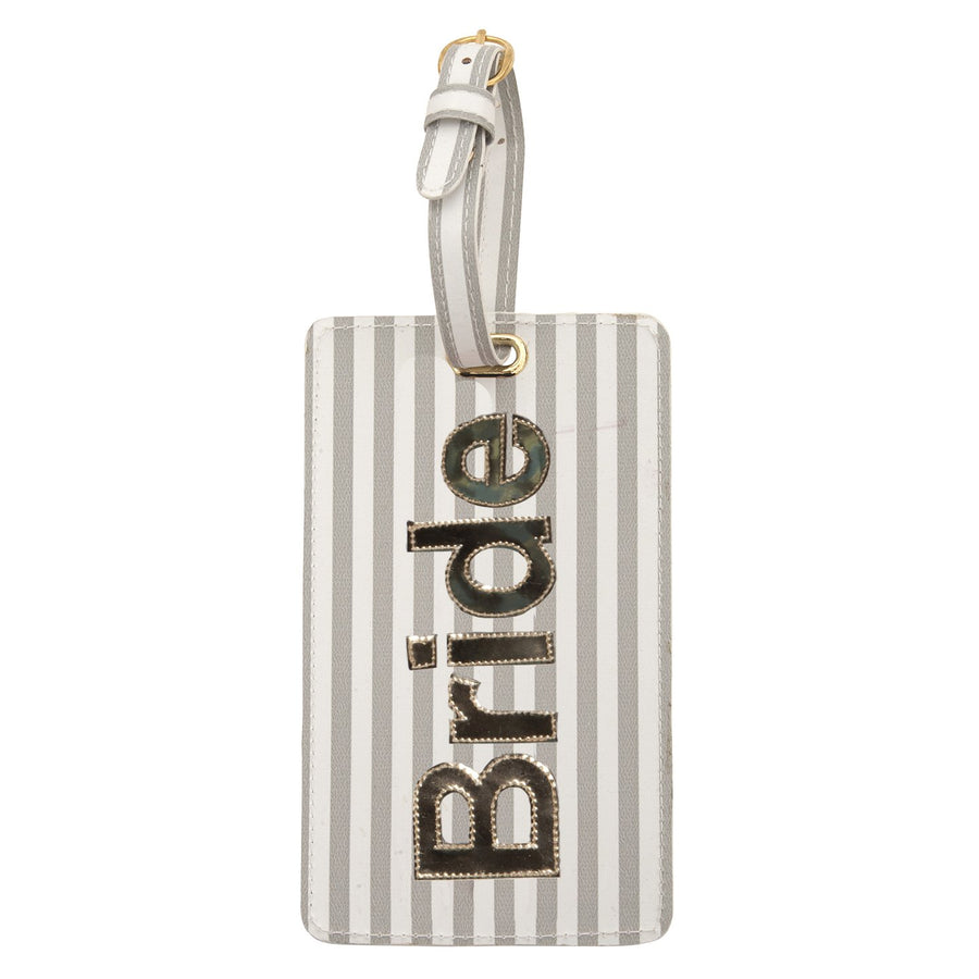 Luggage tag in wide gray stripes with shiny gold bride