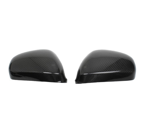 Carbon mirror caps for the Alfa 159/Giulietta/Mito.  Carbon Fiber mirror caps replace your oem part, this part will come with a high UV coated finish. Perfect fit, and perfect replacement for your old outdated mirror caps.     -Real 3k dry carbon fiber textured 2x2 twill weave -Brand New Gloosy Carbon Fiber -UV coating protected -Prepreg technology    Package Includes: 1x Alfa 159/Giulietta/Mito Carbon mirror caps