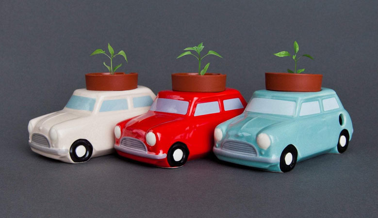 car planters with plants inside