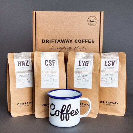 coffee mug with bags of sample coffee