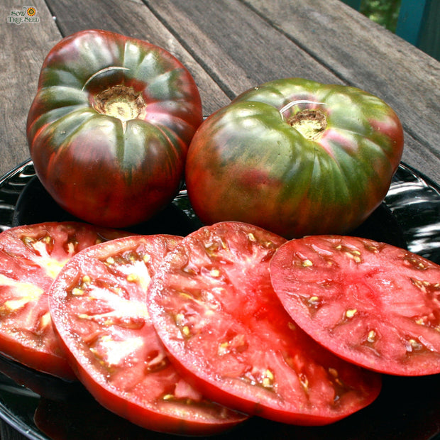 Organic Tomato seeds - Cherokee Purple : Flavorful flattened globes with purplish-pink flesh.