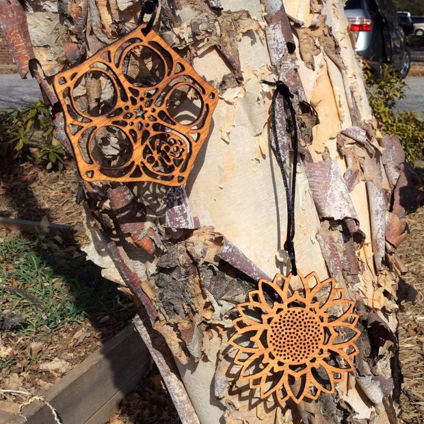 Laser Cut mahogany ornaments are beautiful; hang them anywhere!