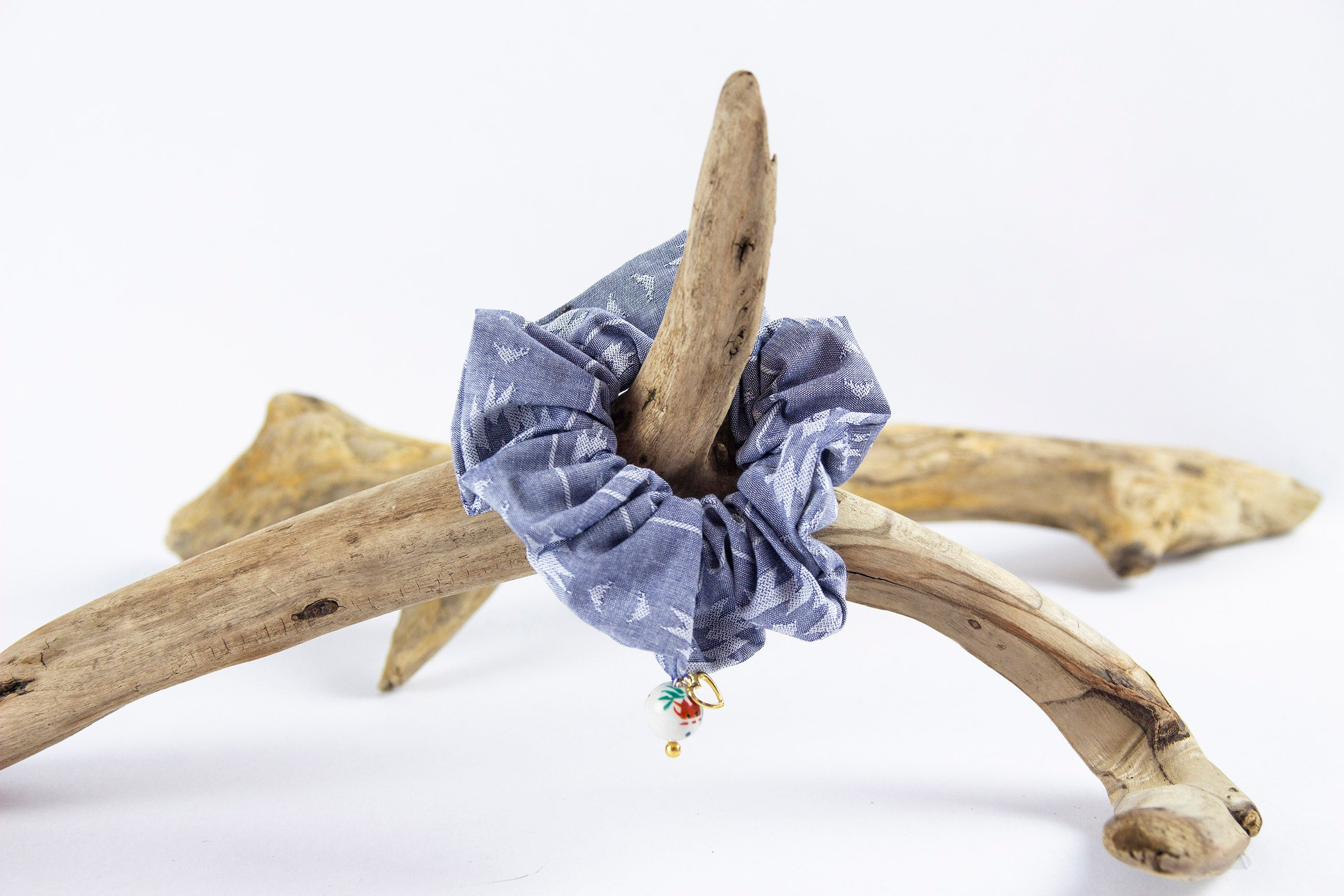 TORO Y PESCADO SANTA FE DENIM SCRUNCHIE WITH FEATHER CHARM