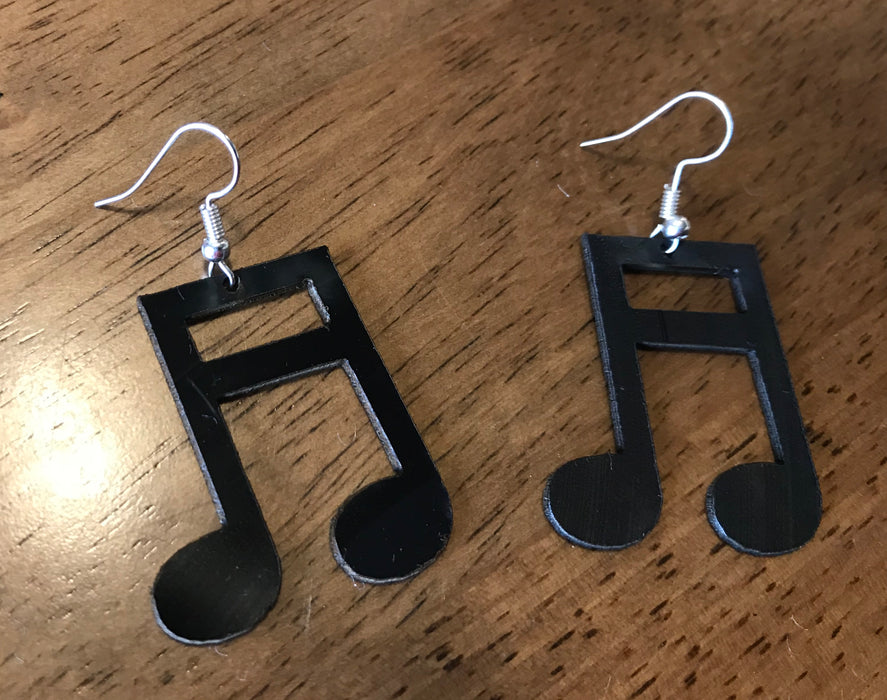 double note earings made from recycled vinyl records