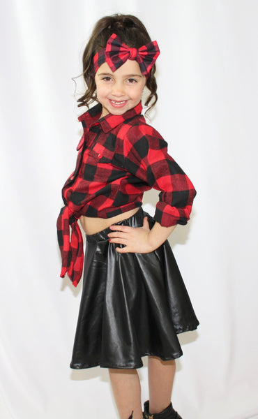 Sassy and Chic! This two piece set is a perfect twist on a typical Fall outfit. The set includes long sleeve top that ties in a knot in the front and a leather skirt (headband sold separately). Your little diva will feel like a Rockstar in her adorable sassy plaid skirt set.