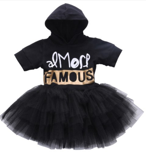 Almost famous tutu dress. Black hooded dress with tulle bottom. White and gold foil ink.