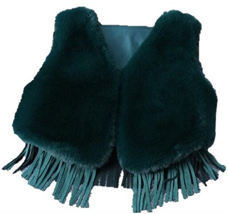 Our Bold Fur Fringe Vest is stunning! This faux fur is oh so soft and the color pops. The bottom of the vest has fringes. Perfect soft and cozy vest for the chilly days.