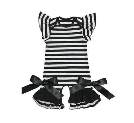 Black and white striped bell bottom romper with black ribbon bows tied at the bottom