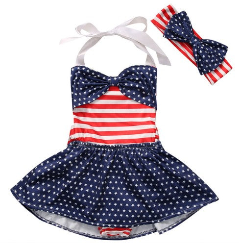 One piece flag inspired bathing suit with big bow and white halter straps. Set comes with matching headband with a big blue polka dot bow.
