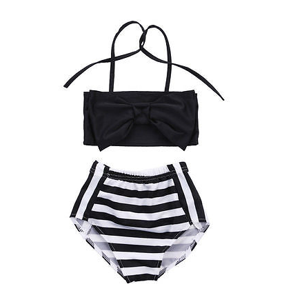 The Classic Coco comes as a two piece set. The top is a bow halter with two strappy tie backs and the bottom is a classic black and white stripe.
