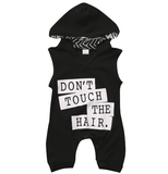Black sleeveless romper with hood. Don't touch the hair on the front graphic and snaps located at the bottom of the romper.