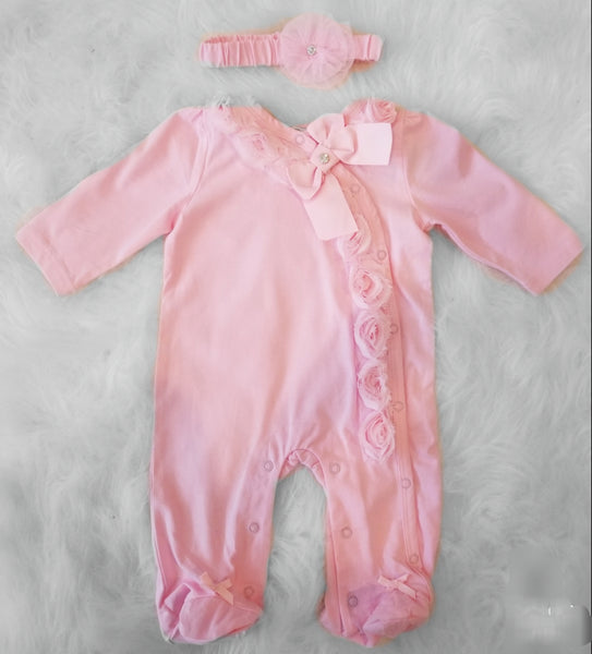 The Baby Love little girl romper set comes with the long sleeve romper and matching headband. The pink romper has rosettes lining the front and bows at the feet. It has the perfect touch of bling with two shiny crystals (one in the headband and one in the top bow) This baby girl romper is perfect for easy changes as it is lined with snaps along the front and bottom.