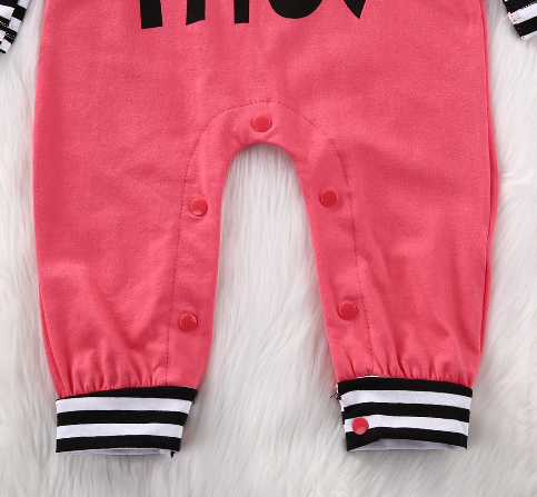 "rose pink romper with black and white stripe sleeves and the saying, "" that bow tho"" located on the front. Snaps are located at the bottom for easy changes."