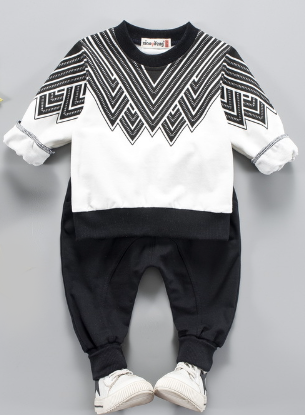 Two piece toddler boy sweatsuit. Long sleeve black and white designed top with black comfy pants with an elastic waist.
