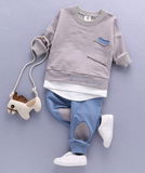 The Retro Set includes long sleeve shirt and pants. This comfy set is perfect for your little man to stay fashionable and comfy. The pale beige and blue colors bring back the retro look.