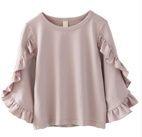The Ruffled Sleeve Top is such a beautiful blouse that can be worn by our baby diva's all the way up to our tween girls! The ruffle design lines the outer and inner part of the sleeves making it super fashionable. The color of the blouse is a blush pink which pairs nicely with jeans or black pants.