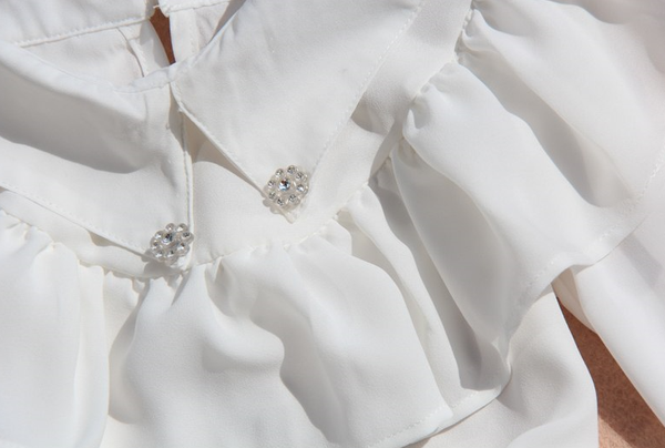 The Classy Coco Chiffon Blouse is perfect for a party, holiday or upscale event. You can wear this blouse so many different ways. We love adding our designer brooch for a real dramatic effect. Each blouse has two rhinestone clips on the top lapels.