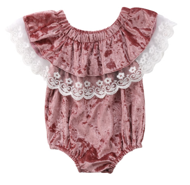 This darling Velvet Ruffle Romper is picture perfect! The romper is covered in crushed pink velvet and the layer of ruffle has lace at the bottom. Your mini diva will look gorgeous in the piece.