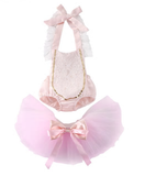 This 2 piece Princess Set is absolutely stunning! The pale pink tutu is super fluffy and ties with a pink and peach bow. The pink romper has a lace halter top that ties in the back. Lining the sides of the romper are gold sequins and lace.