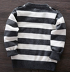 This trendy baby boy's grey striped sweater comes with attached suspenders and a black bow tie with white polka dots.