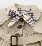 jacket comes with a tie for around the waist and extra fabric to make into a bow for the top button. The extra fabric is on a clasp so you can add or remove as you wish.