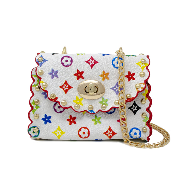 How adorable is our Flower Studded Mini Purse! This super chic mini purse comes comes with a chain shoulder strap and sits long down the waist making it super fancy and stylish. The multi colored floral design gives it a special pop and the studs lining the purse gives it that extra boujie touch! The clasp in the front twists in to lock making sure to keep everything inside nice and safe. Perfect accessory for babies, toddlers and tween fashionistas!  This purse also comes in Brown!