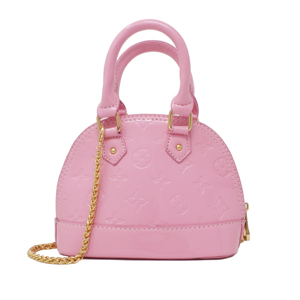 For our chic Boujie Fashionista's, our Patent Mini Purse completes all of our high fashion and dressy outfits. The bag comes with two handles along with a gold chain shoulder strap which hangs long on the side. Great accessory for babies, toddlers and tweens. Available in 3 solid colors - Black, Red and Powder Pink