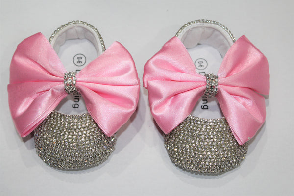 Entire shoe adorned with crystals. Pink Satin bow held together in middle with Crystal band.