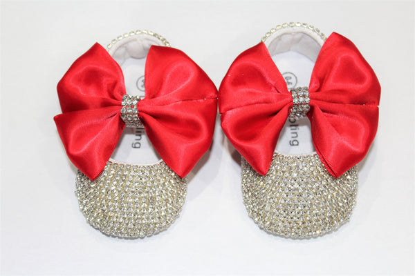 Entire shoe adorned with crystals. Satin red bow held together in middle with Crystal band.