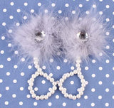Each pair has a fur puff with a big diamond crystal in the middle. Pearls outline the sandal with a small white hook for the babies big toe.