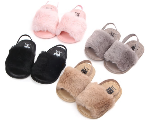 These adorable slippers come in 4 colors (beige, black, grey and pink) and have an elastic strap in the back to secure the slipper. The front of the slipper has a puff of faux fur to cover those little toes. We love this addition to our shoe collection!