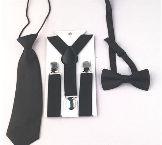 Black 3 piece set includes suspenders, bow tie and tie. Dress any outfit up with these adorable accessories!  The Tie comes on an elastic circle making it super easy to put on. The Bow tie has a small dot design.
