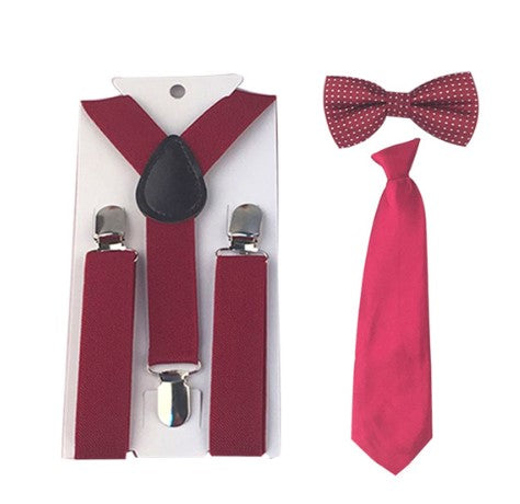 Wine Red 3 piece set includes suspenders, bow tie and tie. Dress any outfit up with these adorable accessories!  The Tie comes on an elastic circle making it super easy to put on. The Bow tie has a small white dot design.
