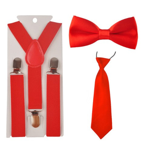 Red 3 piece set includes suspenders, bow tie and tie. Dress any outfit up with these adorable accessories!  The Tie comes on an elastic circle making it super easy to put on. The Bow tie has a small white dot design.