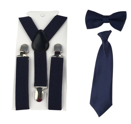 Navy Blue 3 piece set includes suspenders, bow tie and tie. Dress any outfit up with these adorable accessories!  The Tie comes on an elastic circle making it super easy to put on.