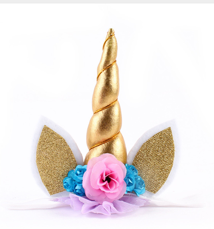 This elastic headband has a gold unicorn spiral horn, gold glitter ears, pink and blue flowers and a purple ruffle underlay.The elastic headband is white.