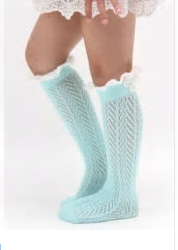Our Knee High socks can be worn by mini fashionista's ages 3-6. We have two colors; Powder Blue and Pink. Each sock comes with a white ruffle lace located at the top and a structured pattern throughout the entire sock. Add these adorable accessories to any skirt or long blouse to create a fabulous mini diva look!