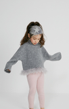Our Petite Hailey Accessories are stunning! These feather headbands are the perfect touch for your budding fashionista. They match all of our dresses in the collection and come in four colors. The glitter shaped star sits on top of a wide feather extending throughout the headpiece