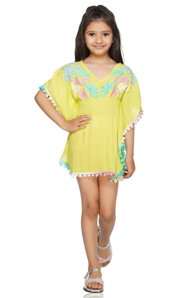 This vibrant and flowy beach cover up is sure to make your next beach trip a breeze! The Ultra-Soft fabric is designed for a super light wear anywhere you go. The embroidering is hand done and very unique. Hand-wash is highly recommended for this cover up.   Don't forget to check out the Mommy and Me matching set to match your mini in style!