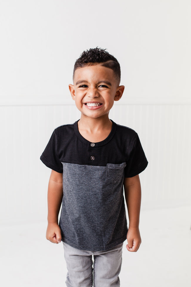 The Littlest Prince Black & Charcoal Block Henley Shirt is for the fashionable little gentleman who likes to take casual up a notch. This cool t-shirt is super comfy and can even be worn under a nice sports jacket with jeans. This set is perfect for stylish brothers as well as for matching daddy!