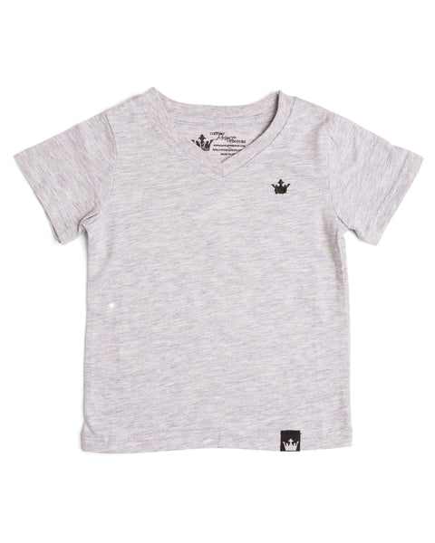The Littlest Prince Gray Crown Logo Tee is sleek and simple which allows you to style it how you please! You can dress it up with a sports jacket or keep it cool with a pair of jeans. It is a v-neck style which keeps your little man totally stylish. Available in baby, toddler and tween sizes!