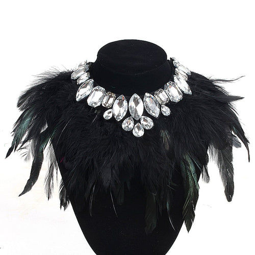 Our Diamond Glitz necklace is stunning!  This makes the perfect addition for our mini diva's all the way up to our mama diva's.This necklace sits high on top of your existing shirt and is lined with Solid black and hints of evergreen long feathers and shining crystals.  Mix and match with your mini for the perfect stylish accessory!