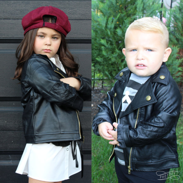 Black toddler baby girl/boy faux leather jacket with zipper. Buttons line the color of the jacket.