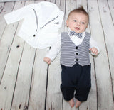 This navy blue & white two piece set is adorable for your little prince. Each set comes with a long sleeve romper (vest and bow tie attached) and a white jacket with navy blue striped piping along the rim of the jacket.