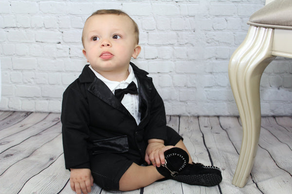 Gearing up for a fancy party? We have your little man covered with our awesome 2 piece suit set. The Classic Gentleman set comes with the one piece romper (bow tie attached and snaps at the bottom) and black cotton jacket. The jacket is not a suit jacket; it is a comfy cotton to keep your little guy comfortable. This set has all of the check lists for a super fancy outfit but will keep your baby happy because he will feel like he is in pj's!