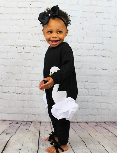 This little girl Swan romper is a super chic casual piece. The bottom is lined with snaps which make it east for changes! The sides of the romper have fluffy white tulle sticking out on the side. This is a perfect outfit for a chill Fall day!