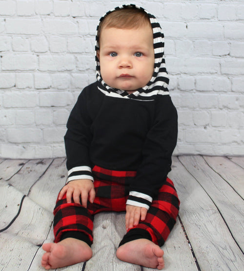 This adorable Hunter 2 piece set for you little man is perfect for stepping into the Fall season. The long sleeve top has a striped hood and pockets. The red patch design lines the pockets and the pant legs with a comfortable elastic waist.