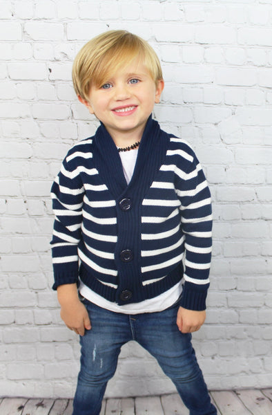 The Nautical baby/toddler boy sweater is a beautiful navy blue heavy knit sweater that will keep your little man nice and toasty. This sweater will fashionably last into winter and can be worn underneath a heavy coat if need be. It looks like a summer Hamptons vibe but will serve it's purpose during those cold winter nights.